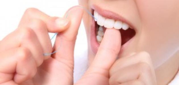 أهمية استخدام خيط الأسنان